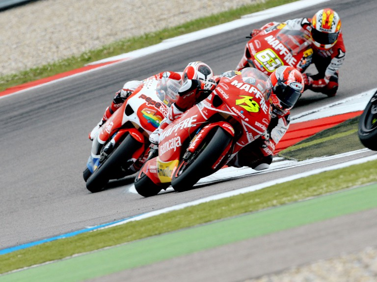 Álvaro Bautista riding ahead of 250cc group in Assen