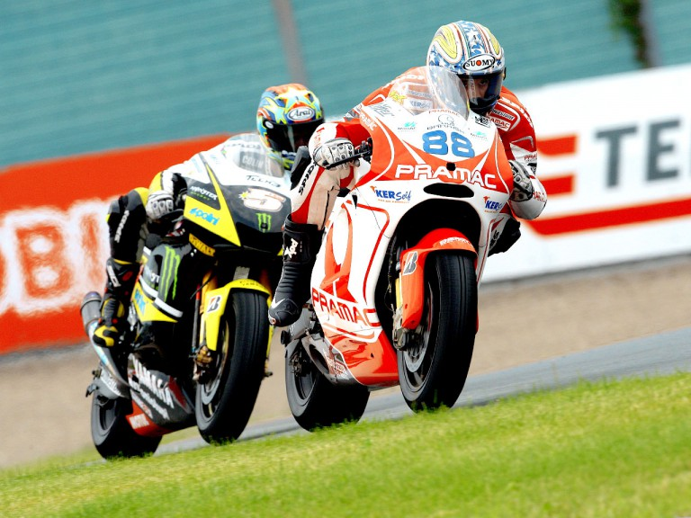 Niccolò Canepa riding ahead of Colin Edwards in Sachsenring
