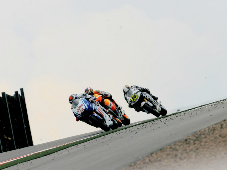 Jorge Lorenzo riding ahead of Andrea Dovizioso and Randy de Puniet in Sachsenring