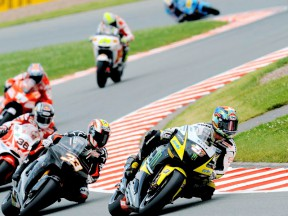 Colin Edwards riding ahead of MotoGP group in Sachsenring