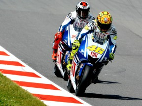 Valentino Rossi riding ahead of Jorge Lorenzo in Sachsenring