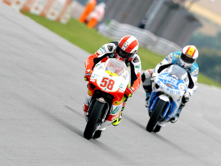 Marco Simoncelli riding ahead of Alex Debon in Sachsenring