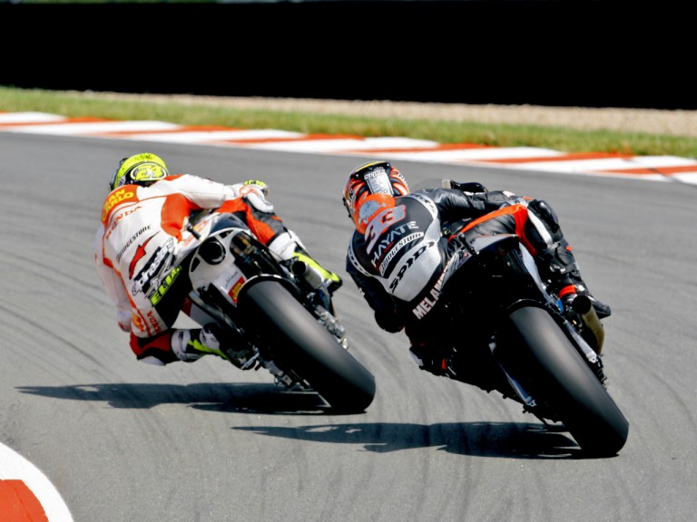 Toni Elias riding ahead of Marco Melandri in Assen