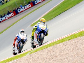 Yamaha riders Rossi and Lorenzo in action in Sachsenring