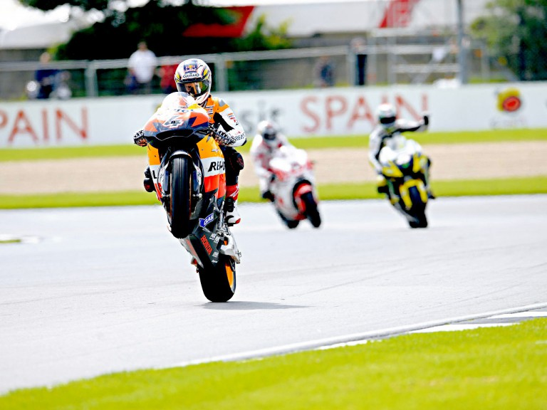 Andrea Dovizioso pulls off a wheelie in Donington