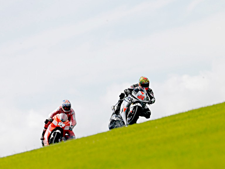 Gabor Talmacsi riding ahead of Nicky Hayden in Donington