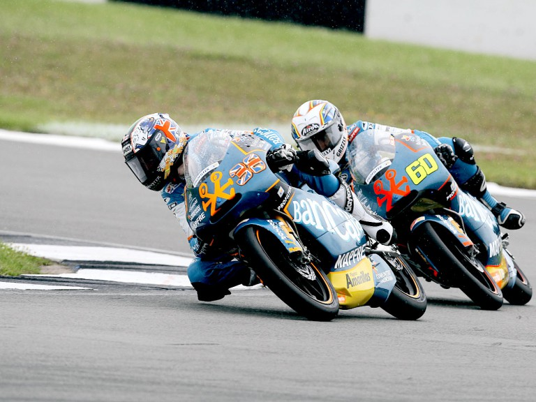 Bradley Smith riding ahead of Julián Simón in Donington