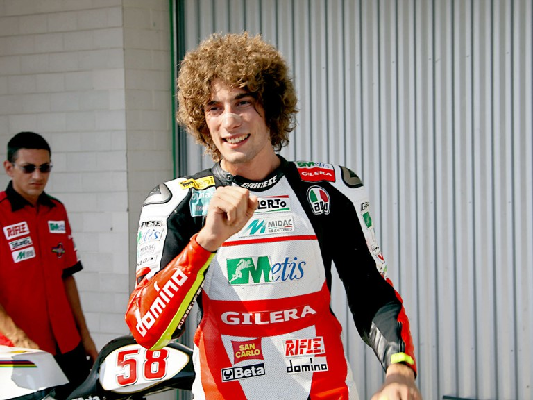 Marco Simoncelli at the parc fermé after QP in Brno
