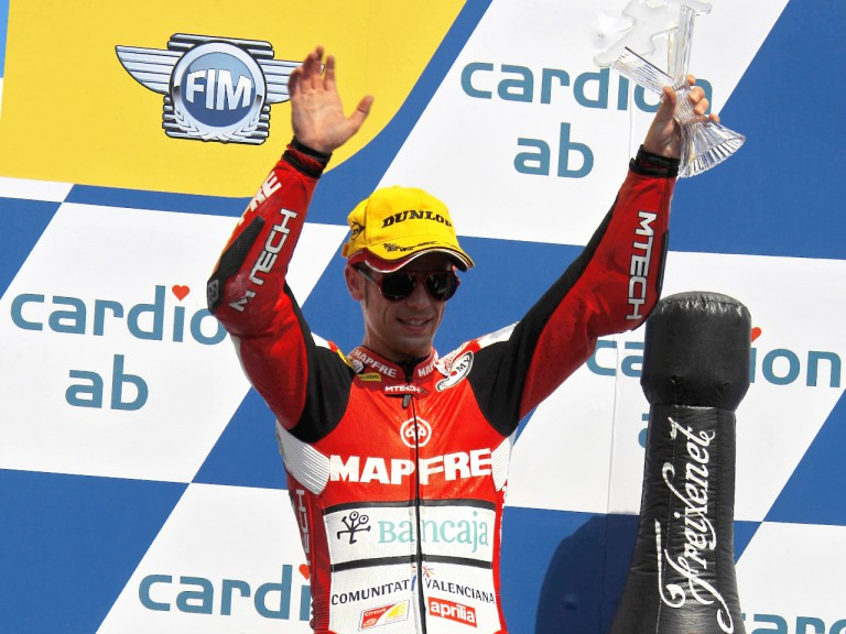 Álvaro Bautista o the podium at Brno