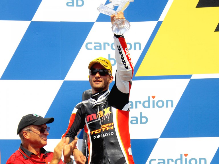 Mattia Pasini on the podium at Brno