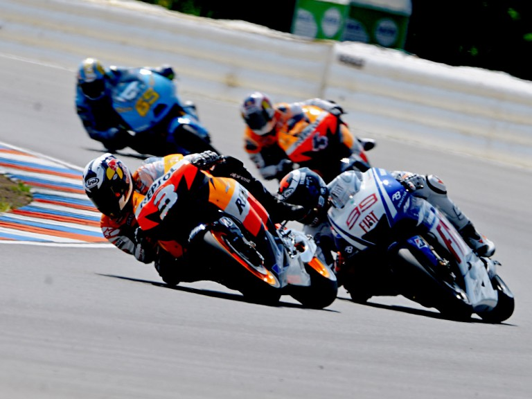 Dani Pedrosa riding ahead of MotoGP group