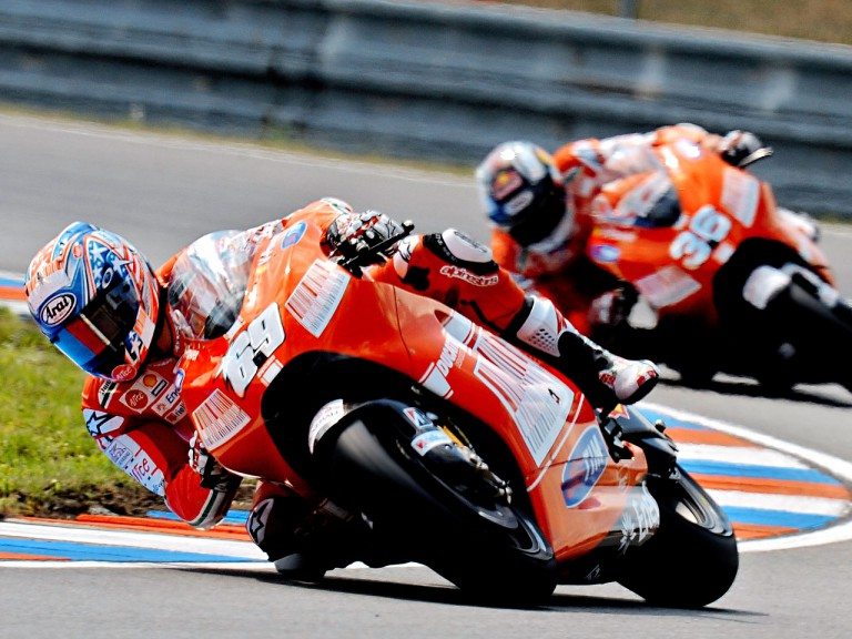 Nicky Hayden and Mika Kallio in action