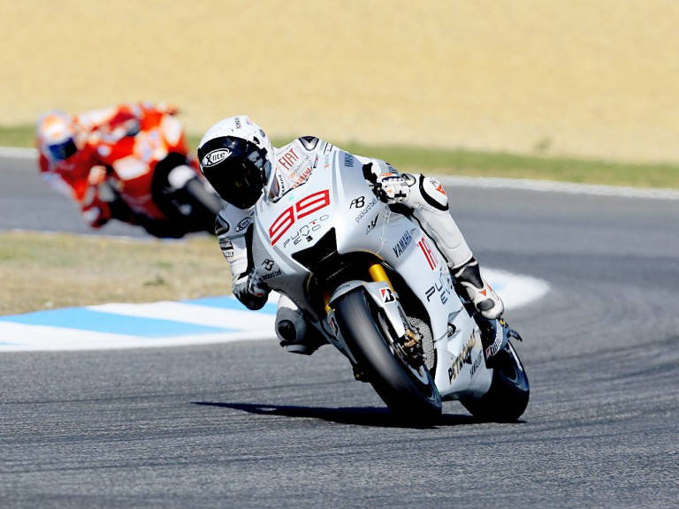 Lorenzo riding ahead of Stoner in Estoril
