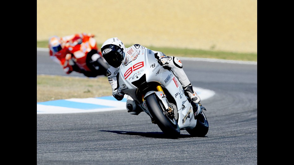 Lorenzo riding ahead of Stoner in Estoril