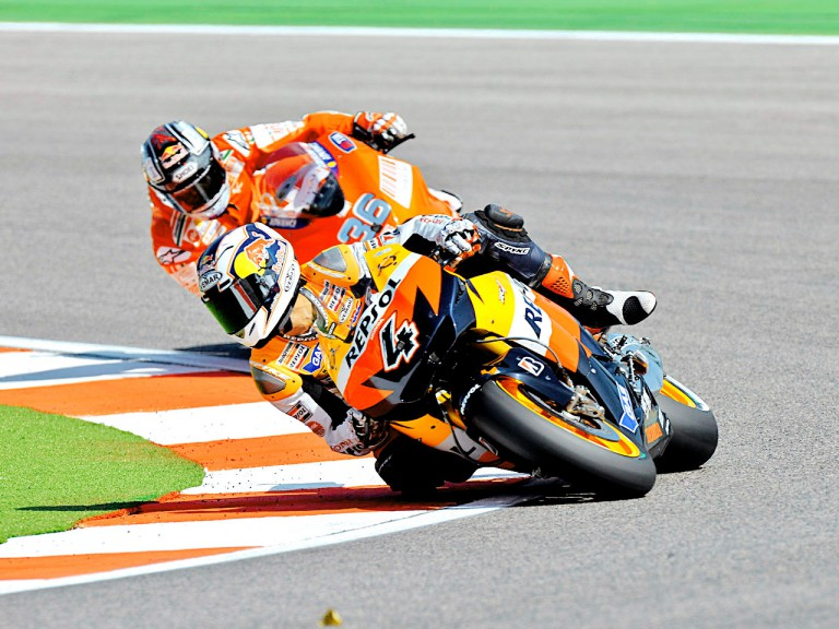 Andrea Dovizioso riding ahead of Mika Kallio in Misano