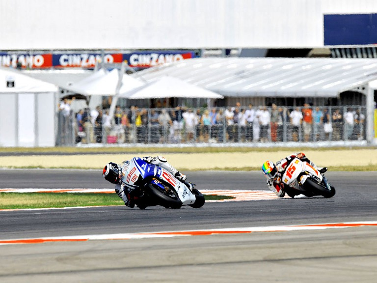 Jorge Lorenzo riding ahead of Alex de Angelis in Misano