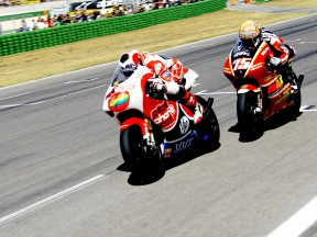 Héctor Barberá riding ahead of Mattia Pasini during 250cc race in Misano