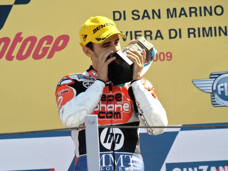 Héctor BArberá on the podium at Misano