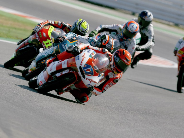 Stefan Bradl riding ahead of 125cc group in Misano