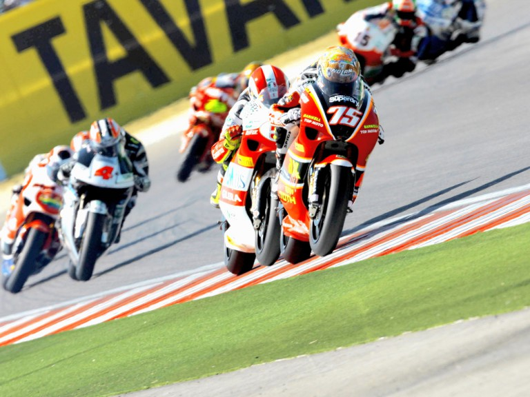Mattia Pasini riding ahead of 250cc group in Misano