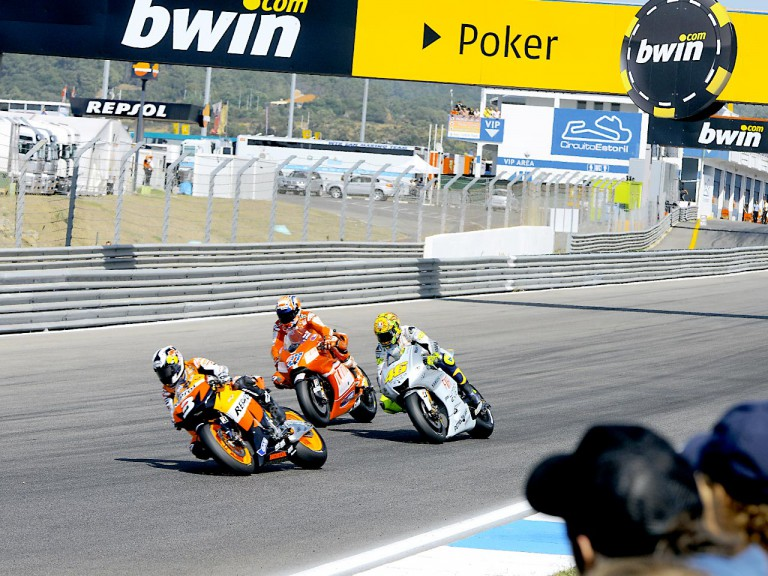 Pedrosa riding ahead of Stoner and Rossi at Estoril