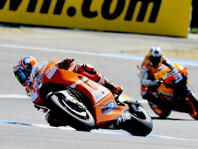 Casey Stoner riding ahead of Dani Pedrosa in Estoril