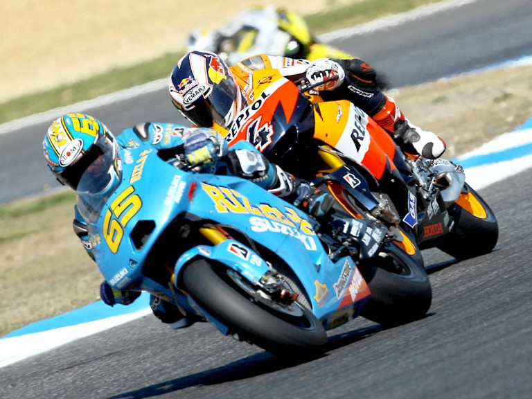 loris Capirossi riding ahead of Dovizioso in Estoril
