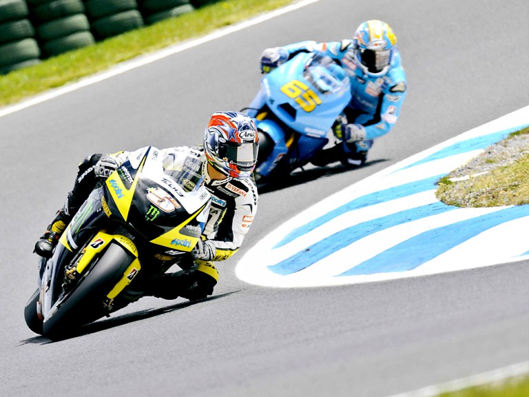 Colin Edwards and Loris Capirossi in action in Phillip Island