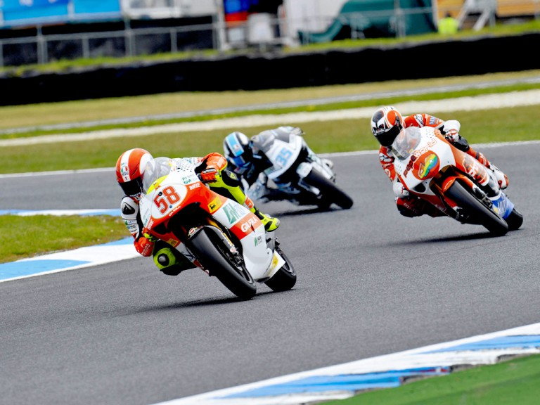 Simoncelli riding ahead of Barberá and De Rosa in Phillip Island