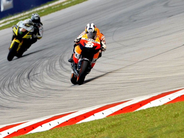 Pedrosa riding ahead of Edwards in Sepang