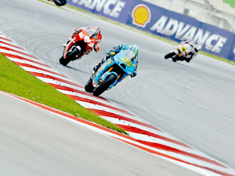 Capirossi riding ahead of Hayden in Sepang