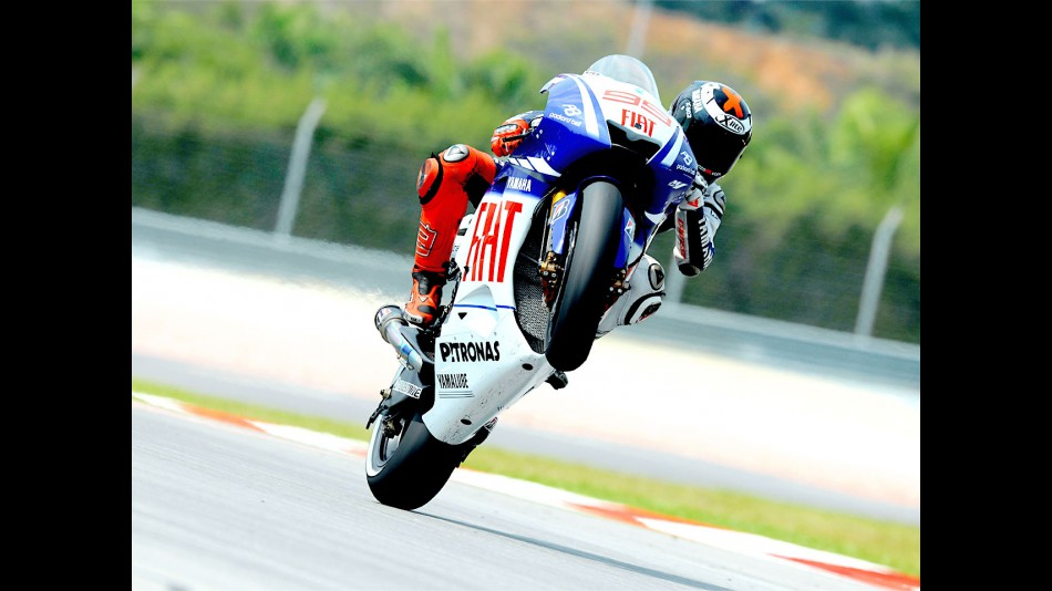 Lorenzo Pulls off a wheelie in Sepang