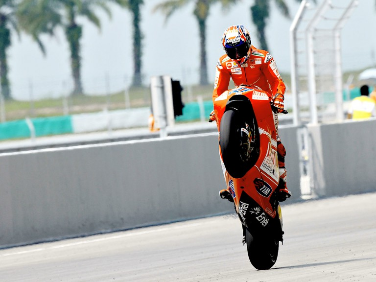 Casey Stoner pulls off a wheelie in Sepang