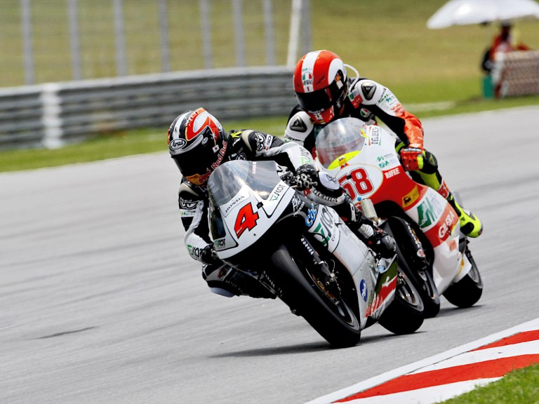 Aoyama riding ahead of Simoncelli in Sepang
