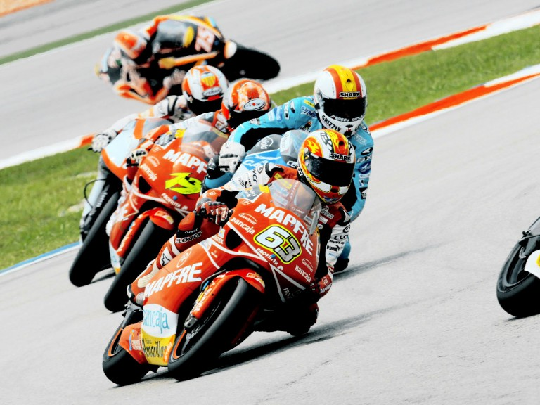 Mike di Meglio riding ahead of 250cc group in Sepang