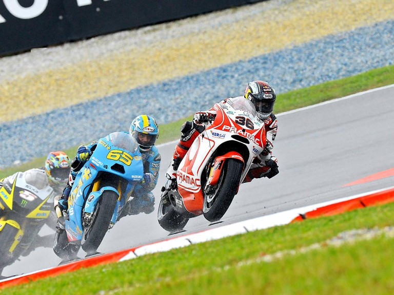 Kallio riding ahead of Capirossi and Edwards in Sepang