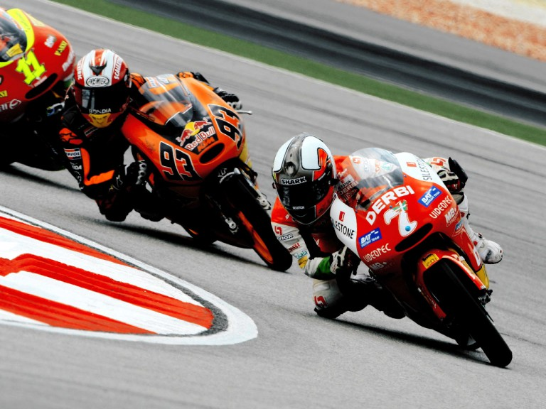 Efrén Vázquez riding ahead of Marc Márquez in Sepang