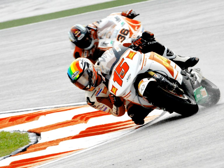 De Angelis riding ahead of Kallio in Sepang