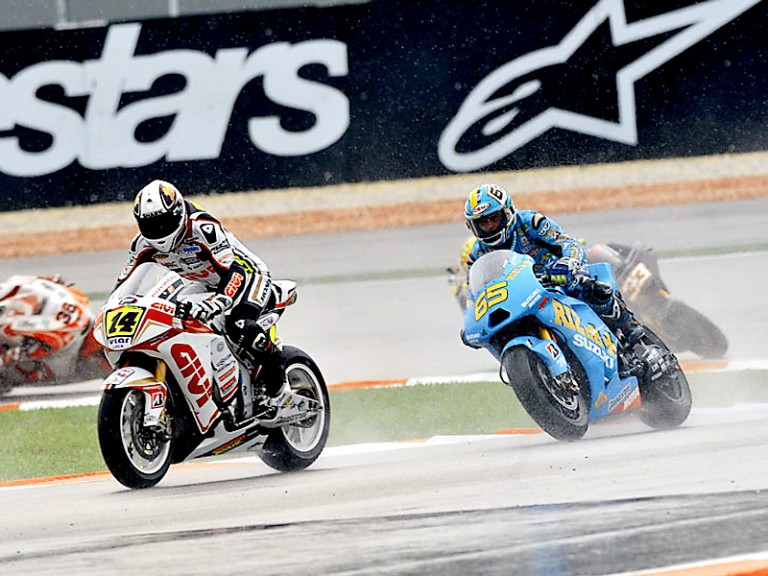 Randy de Puniet riding ahead of Capirossi in Sepang
