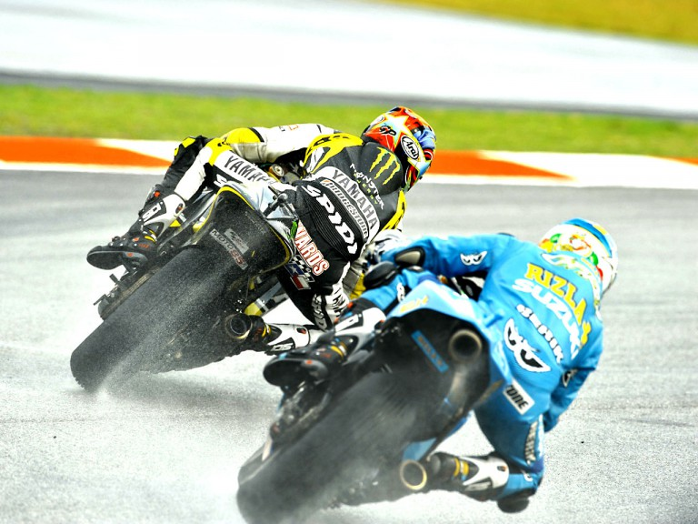 Edwards riding ahead of Capirossi in Sepang