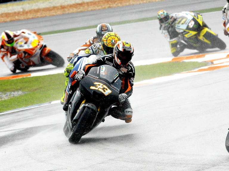 Marco Melandri riding ahead of MotoGP group in Sepang