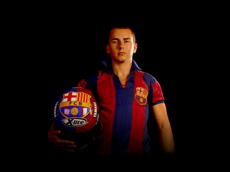 Jorge Lorenzo in FC Barcelona colours for Caya-África