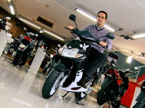 Fantasy MotoGP 2009 winner Jorge Porcar with his Yamaha scooter