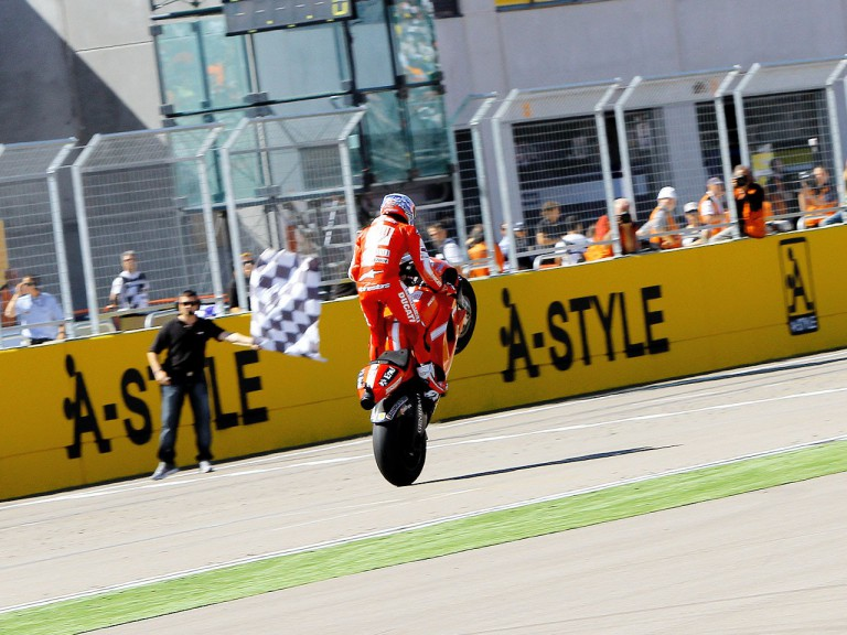 Casey Stoner pulls off a wheelie at the finish of the race at Motorland Aragón