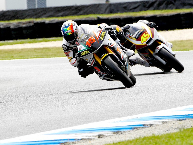 Alex de Angelis riding ahead of Redding at Phillip Island