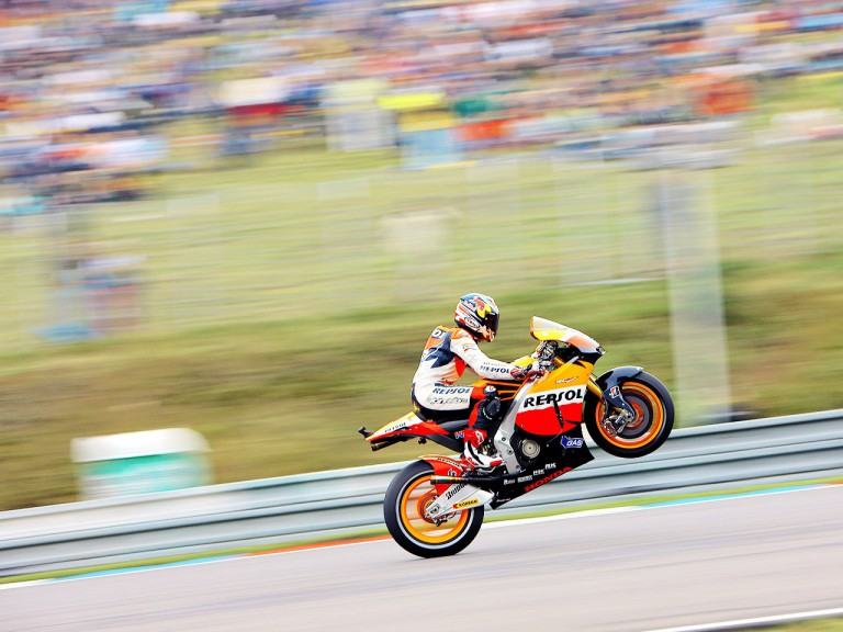 Andrea Dovizioso pulls off a wheelie during QP in Brno