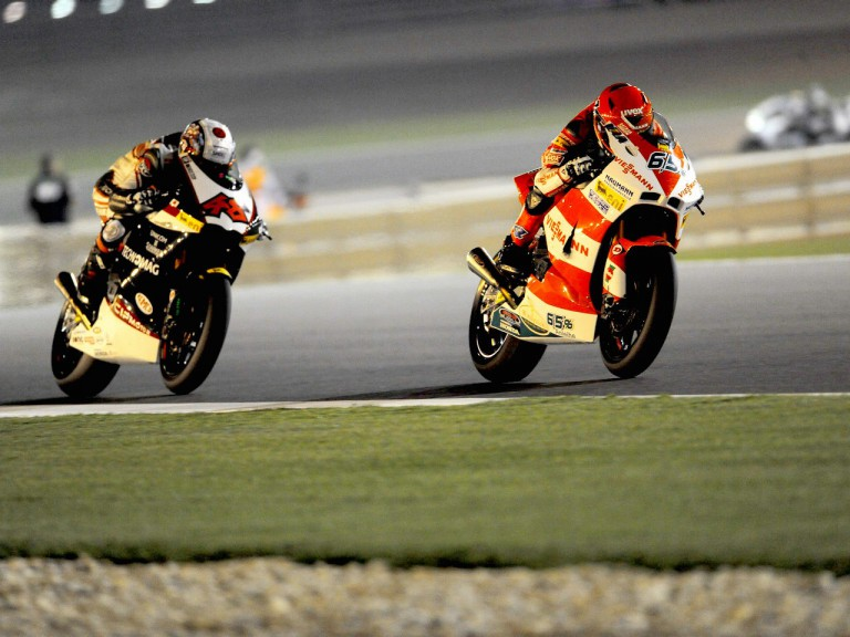 Stefan Bradl and Shoya Tomizawa in action in Qatar