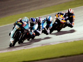 Nico Terol riding ahead of 125cc group in action in Qatar