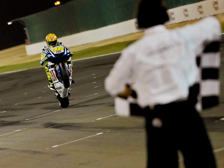 Valentino Rossi pulls off a wheelie at the finish of the race in Qatar