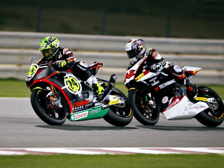 Toni Elias riding ahead of Tomizawa in Qatar